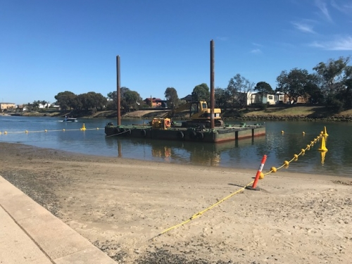 Our floating barrier buoys and exclusion zone stand up marker buoys being used to corden off a barge and excavator working on the Patterson River, Carrum, Victoria.