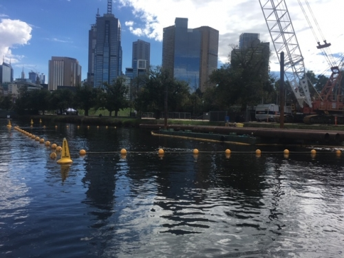 Floating buoy line and exclusion zone stand up buoys, outlining an exclusion zone at a work site on the Yarra River.