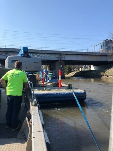 Using Maya's Bay work boat to push a barge and excavator up the Yarra River.
